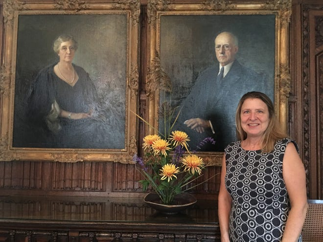 Cheryl Linck, talented Ikebana designer, created the floral arrangement which is if front of the portraits of Ellen Scripps Booth and George Gough Booth, founders of Cranbrook and the Japanese Garden.