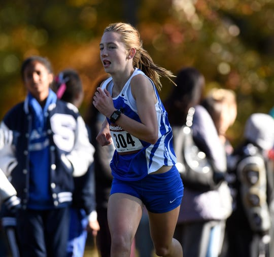 Salem's Kiersten McBride finishes 16th overall at the KLAA girls cross country championship held Oct. 18 at Huron Meadows Metropark.