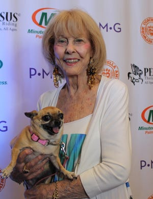 Jackie Story with Princessita, one of her dogs.
