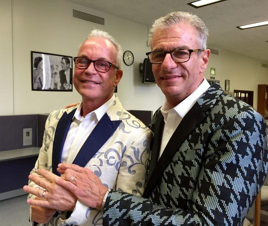 Robert Julian Stone (left) and his husband, Robert Maietta, in Mr Turk jackets on their wedding day