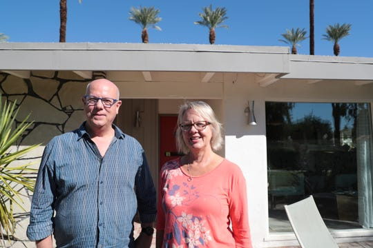 Melissa Riche and Jim Riche, author and photographer of Mod Mirage stand in front of their mid-century home in Rancho Mirage on Wednesday, October 18, 2018.