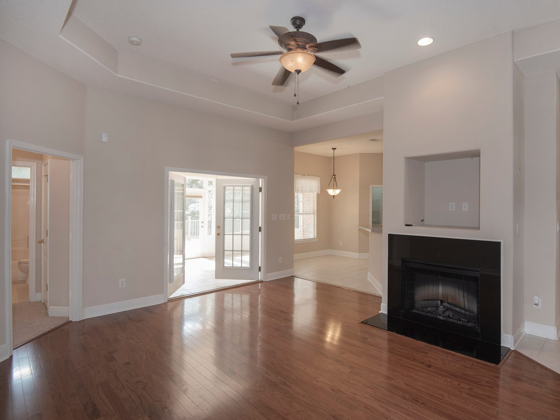 2363 Queens Ferry LaneThe living room space is open to the kitchen and includes a fireplace.
