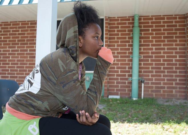 Tekira Thomas, 11, gets some fresh air while staying at the Northside Elementary School Red Cross Shelter after Hurricane Michael in Panama City, Florida on Wednesday, October 17, 2018.  Tekira says that there have been plenty of activities provided by volunteers to keep her, her brothers, and other children occupied at the shelter.