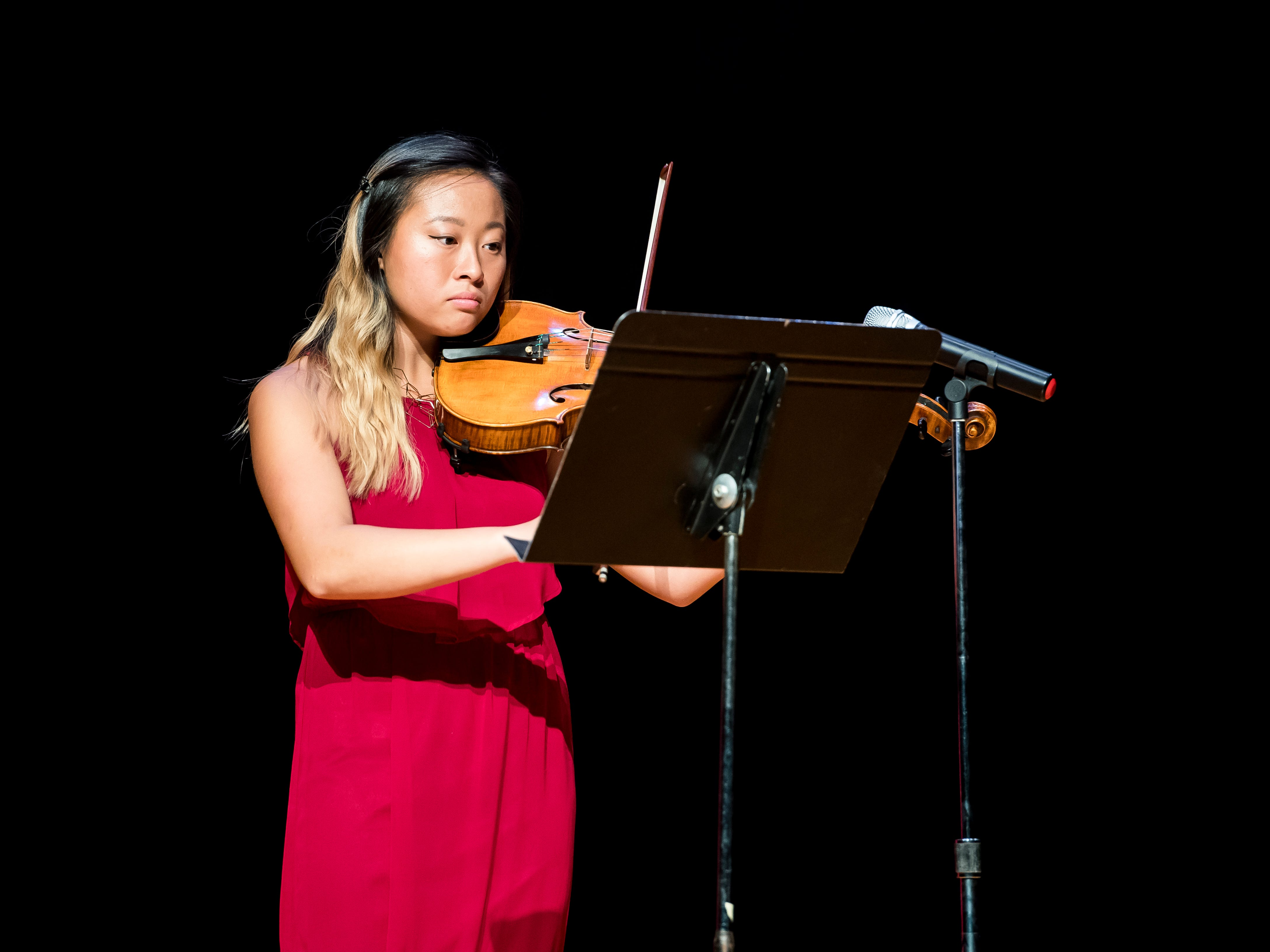 South Western's Karen Yang plays the viola during a rehearsal session for the Miss Hanover Area pageant at New Oxford High School on Oct. 17, 2018.