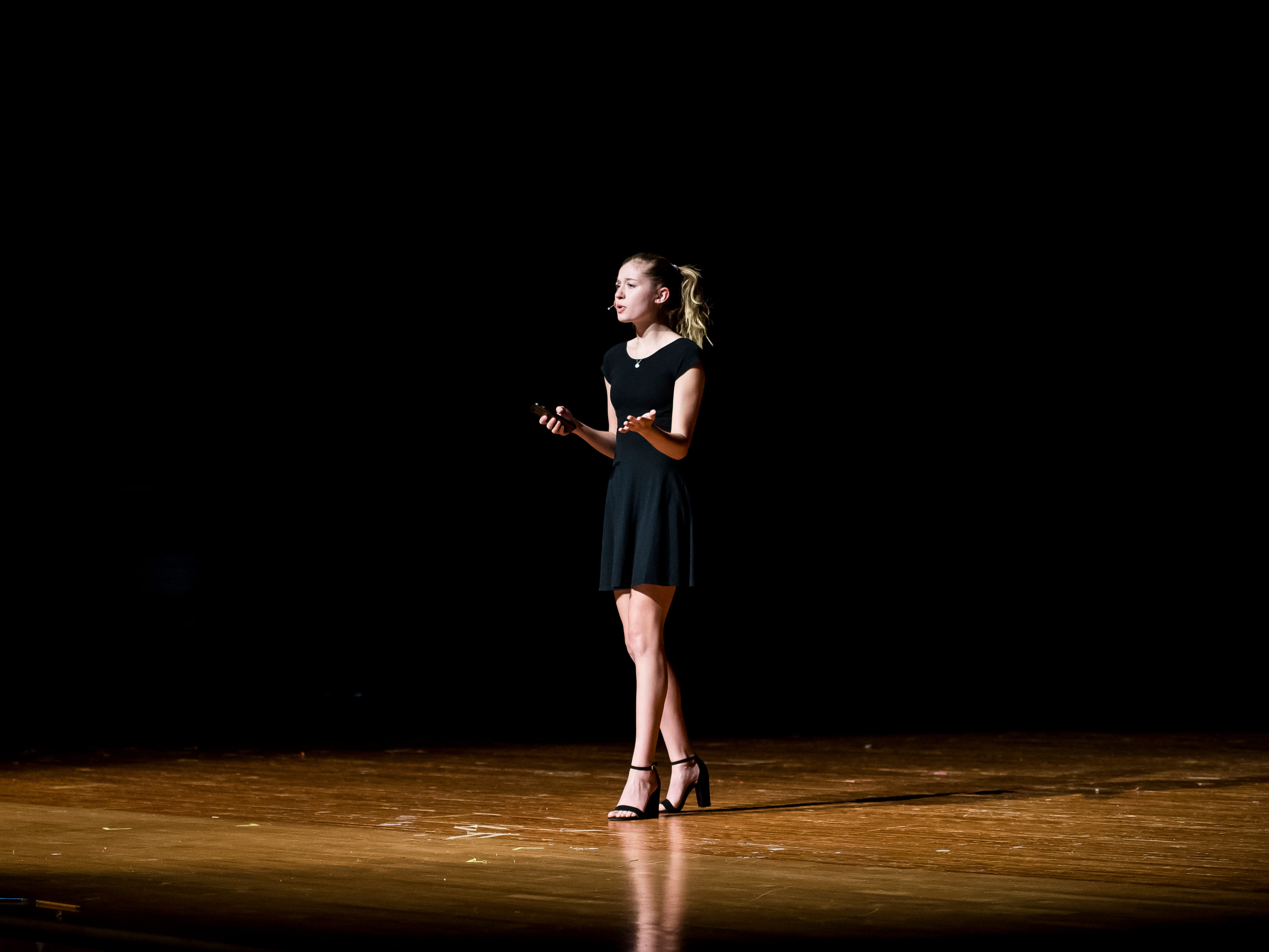 South Western's Grace Dickmyer performs an original poem during a rehearsal session for the Miss Hanover Area pageant at New Oxford High School on Oct. 17, 2018.