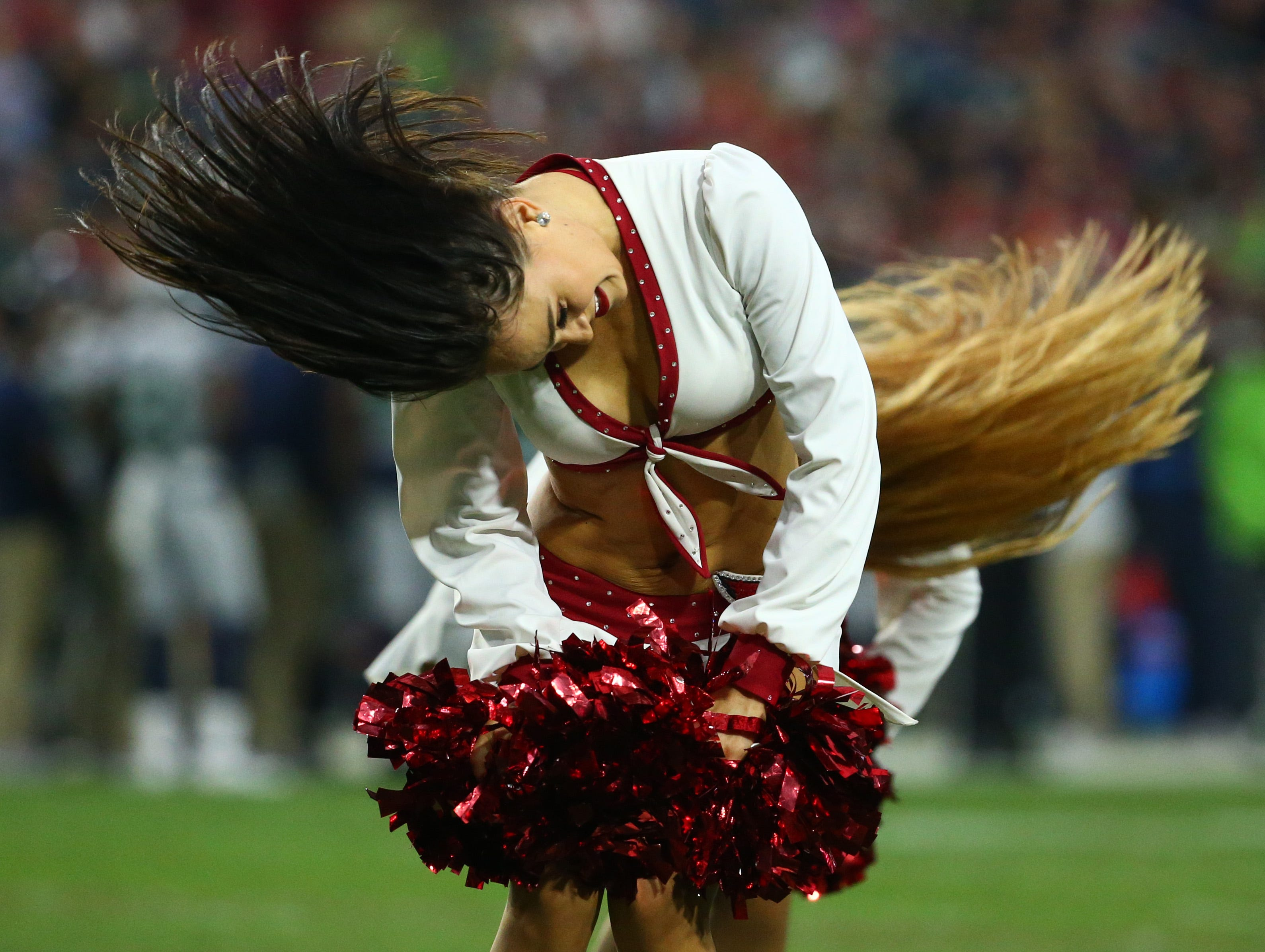 Arizona Cardinals cheerleaders perform in the first half at State Farm Stadium in Glendale, Ariz. on Sept. 30, 2018.