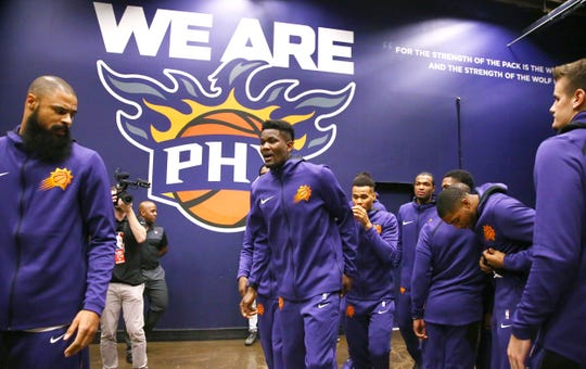 Deandre Ayton gets ready for his NBA debut before a game against the Mavericks on Wednesday at Talking Stick Resort Arena.