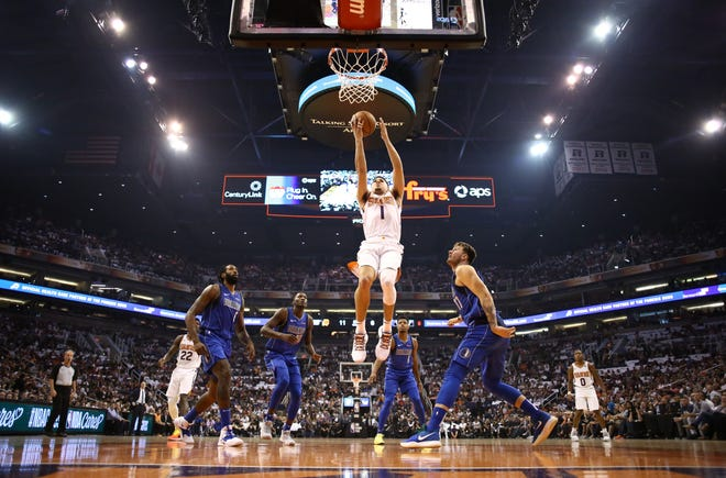 Devin Booker finished with 35 points in the Suns' season opening victory over the Mavericks on Wednesday at Talking Stick Resort Arena.