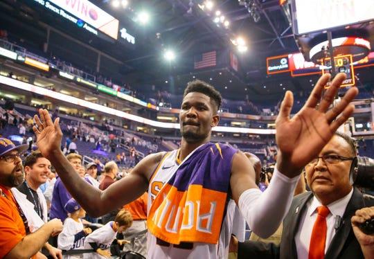 Oct 17, 2018; Phoenix, AZ, USA; Phoenix Suns center Deandre Ayton (22) celebrates after defeating the Dallas Mavericks at Talking Stick Resort Arena. Mandatory Credit: Mark J. Rebilas-USA TODAY Sports