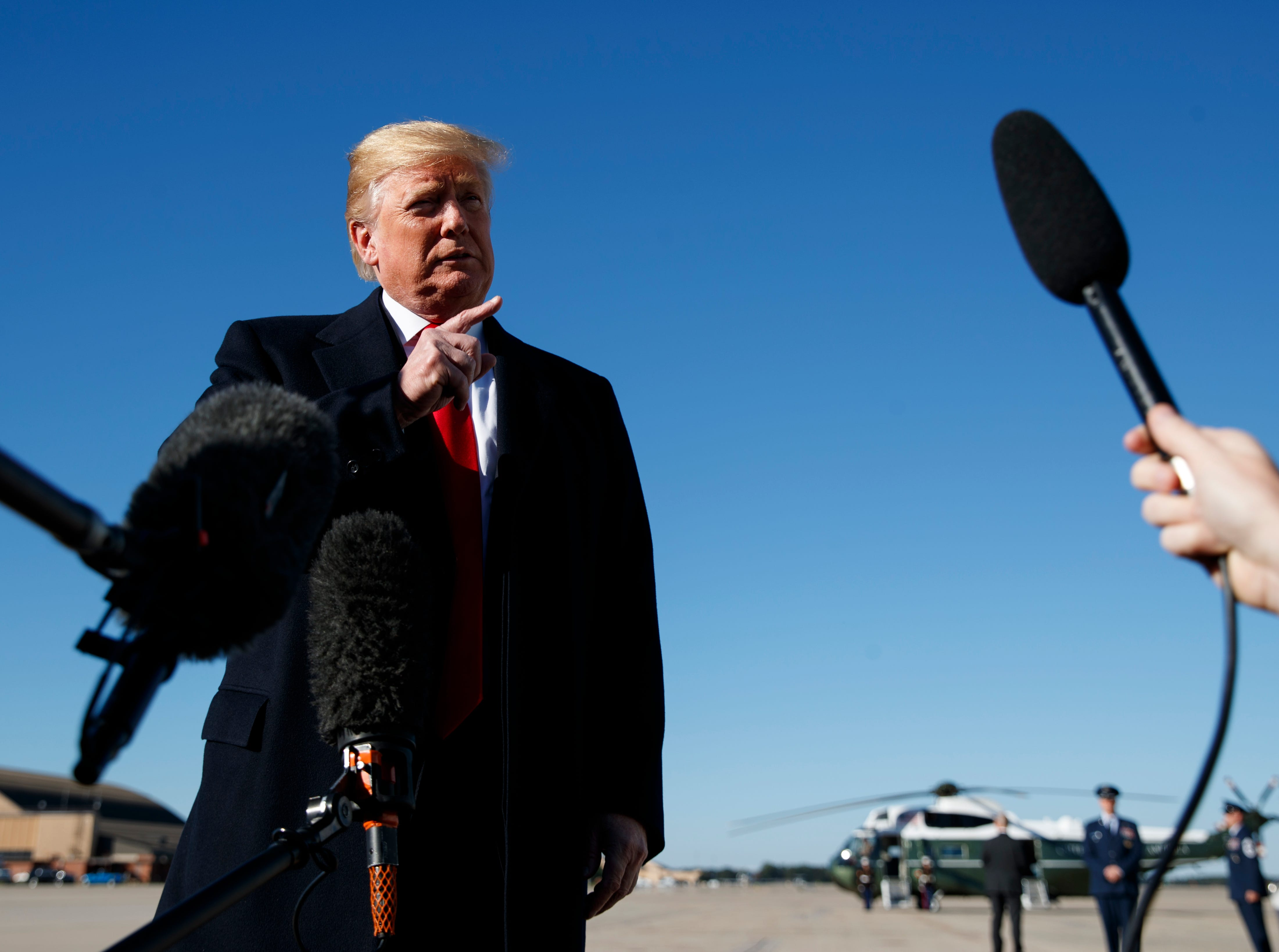 President Donald Trump talks to reporters Oct. 18, 2018, before boarding Air Force One in Andrews Air Force Base, Maryland, en route to campaign stops in Arizona, Montana and Nevada.