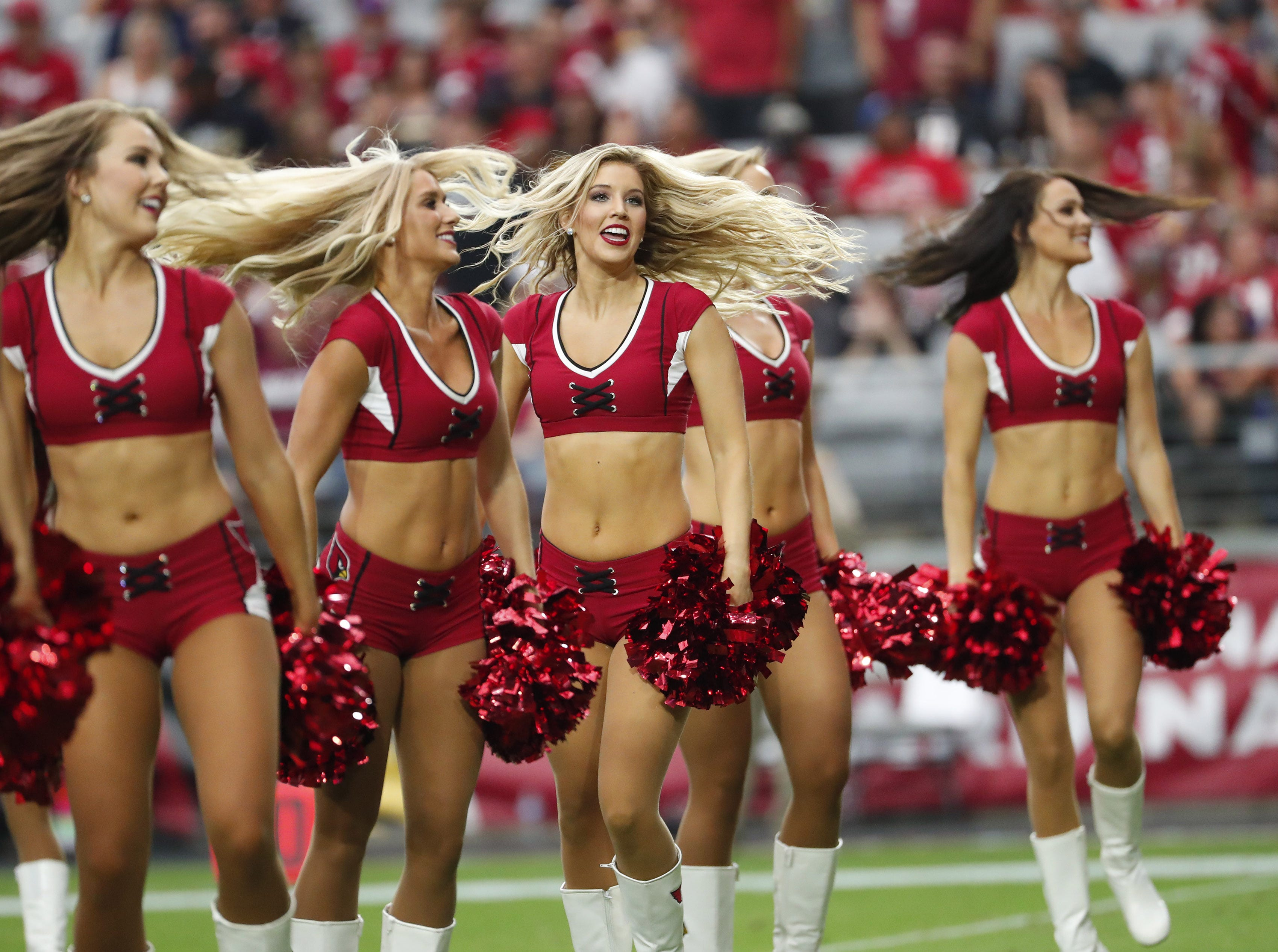 Arizona Cardinals cheerleaders perform during a break against the Washington Redskins at State Farm Stadium in Glendale, Ariz., on Sept. 9, 2018.