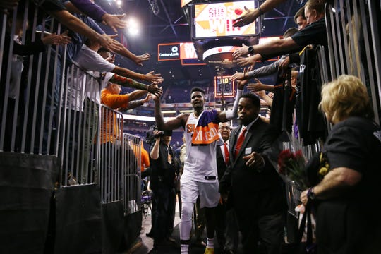Deandre Ayton is greeted by fans after the Suns' 121-100 win over the Mavericks on opening night at Talking Stick Resort Arena.