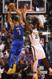 Suns center Deandre Ayton defends Mavericks power forward Dwight Powell during a game Wednesday at Talking Stick Resort Arena.