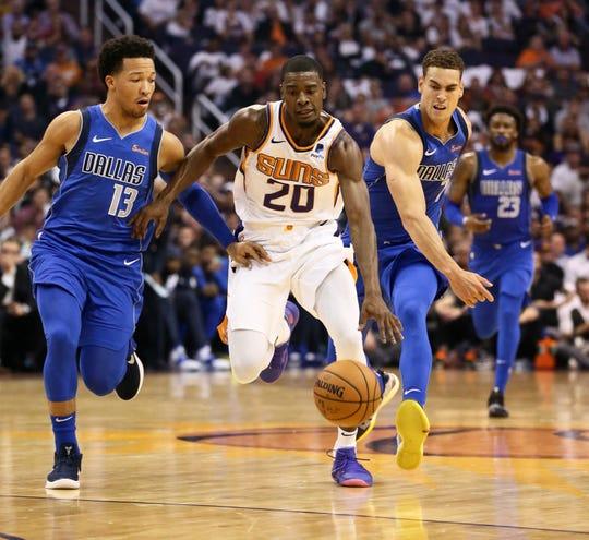 Josh Jackson is pressured by Mavericks guard Jalen Brunson during the Suns' season opener Wednesday.