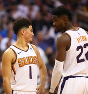 Devin Booker had 35 points with seven assists while rookie Deandre Ayton had 18 points with 10 rebounds in the Suns' season opening victory over the Mavericks.