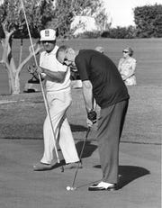 President Lyndon Johnson lines one up while golfing at Arizona Biltmore.