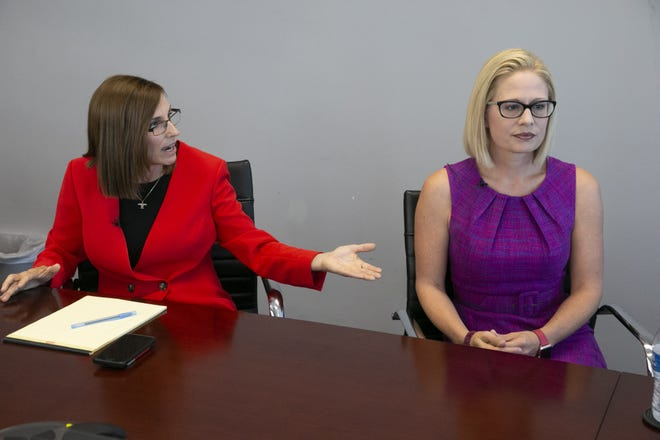 Republican Martha McSally (left), who is vying for a U.S. Senate seat for Arizona against Democrat Kyrsten Sinema, speaks with The Arizona Republic editorial board and Arizona Republic reporters as Sinema looks on at The Arizona Republic in Phoenix on Wednesday, October 17, 2018.