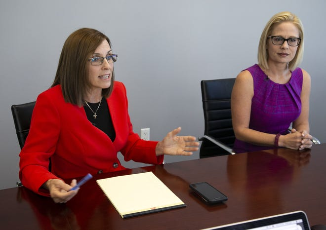 Republican Martha McSally (left) who is vying for a U.S. Senate seat for Arizona against Democrat Kyrsten Sinema, speaks with the Arizona Republic editorial board and Arizona Republic reporters as Sinema looks on at the Arizona Republic in Phoenix on Wednesday, October 17, 2018.