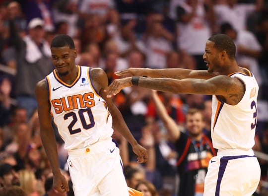 Oct 17, 2018; Phoenix, AZ, USA; Phoenix Suns forward Josh Jackson (20) celebrates with Trevor Ariza in the fourth quarter against the Dallas Mavericks at Talking Stick Resort Arena. Mandatory Credit: Mark J. Rebilas-USA TODAY Sports