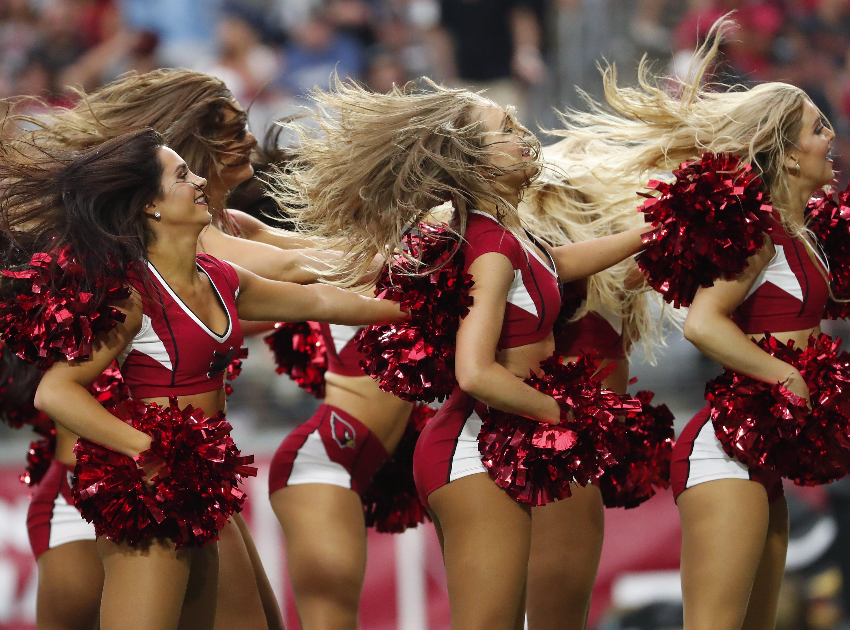 Arizona Cardinals cheerleaders perform during a break against the Washington Redskins at State Farm Stadium in Glendale, Ariz. on Sept. 9, 2018.