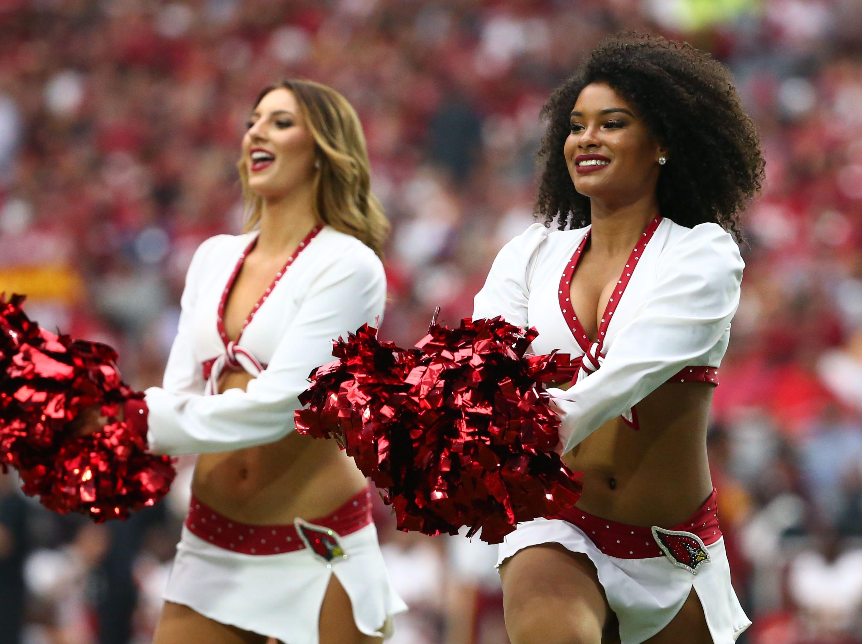 Arizona Cardinals cheerleaders perform in the second half at State Farm Stadium.