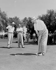 President Dwight D. Eisenhower eyes a putt during a stay at Arizona Biltmore.