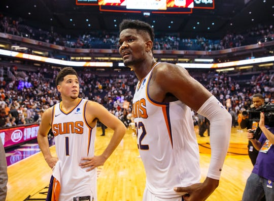 Oct 17, 2018; Phoenix, AZ, USA; Phoenix Suns center Deandre Ayton (22) and guard Devin Booker (1) following the game against the Dallas Mavericks at Talking Stick Resort Arena. Mandatory Credit: Mark J. Rebilas-USA TODAY Sports
