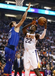 No. 1 overall pick Deandre Ayton scores his first career points over No. 3 pick Luka Doncic during the Suns' season opener Wednesday at Talking Stick Resort Arena.
