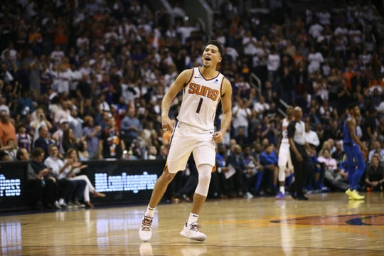Phoenix Suns Devin Booker reacts after being fouled on a 3-point shot against the Dallas Mavericks during the season opener at Talking Stick Resort Arena on Oct. 17, 2018, in Phoenix, Ariz.