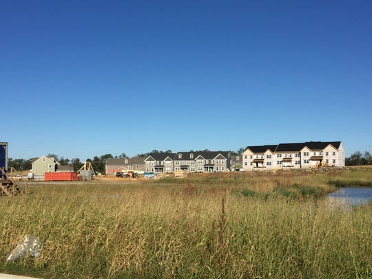 Some homes at North Cornwall Commons are nearing completion nearby where restaurants, a hotel and retail complexes will soon be built.