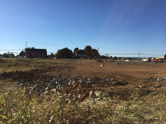 Workers continue preparing lots for restaurants, a hotel and retail centers at North Cornwall Commons.