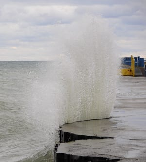 Water jets into the air after striking the breakwater at Port Sanilac.