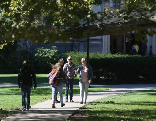 Students walk on Vassar's campus in this October 2018 file photo.