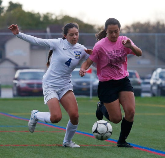 Arlington's Desiree Meehan drives to the goal as Mahopac's Grace DiVincenzo puts the pressure on during Wednesday's game on October 17, 2018.