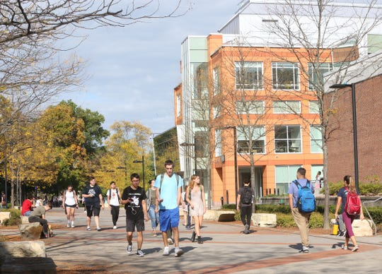 Students walk to class at SUNY New Paltz on October 10, 2018.