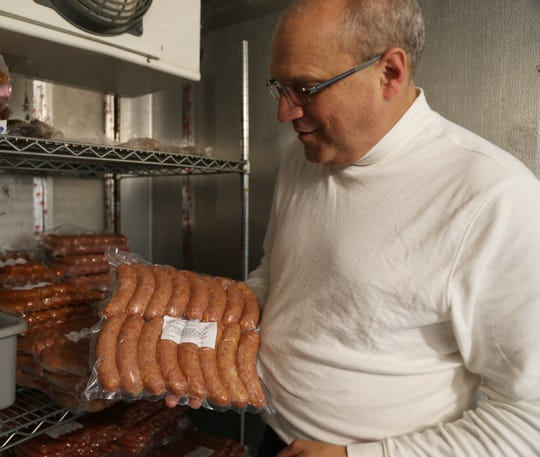 Mark Elia shows off finished sausages at the Hudson Valley Sausage Company's plant in Highland on October 16, 2018.