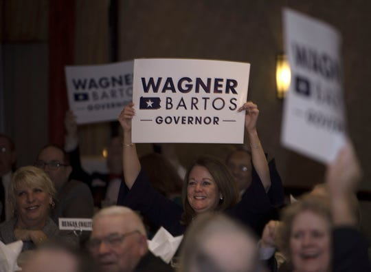 Supporters cheer as Scott Wagner's name is announced. Scott Wagner, candidate for Pennsylvania Governor, was the keynote speaker at the Franklin County Republican Committee's annual Eisenhower Day Dinner on Wednesday, October 17, 2018 at Orchards Restaurant.