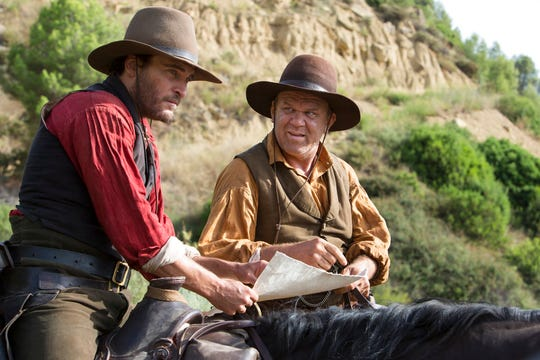 "Joaquin Phoenix, left, and John C. Reilly star in ""The Sisters Brothers."" The movie is playing at Regal West Manchester Stadium 13."