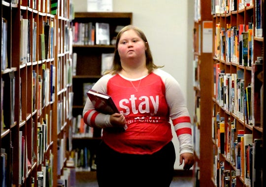 "Ellie Hertig of York City choses a book while on a field trip with her class from Lincoln Intermediate Unit at Martin Library in York City Thursday, October 18, 2018. The library was named ""Library of the Year"" at the Pennsylvania Library Association Annual Conference. Statewide nominations were considered with Martin chosen as the first library in Pennsylvania to earn the award. Bill Kalina photo"