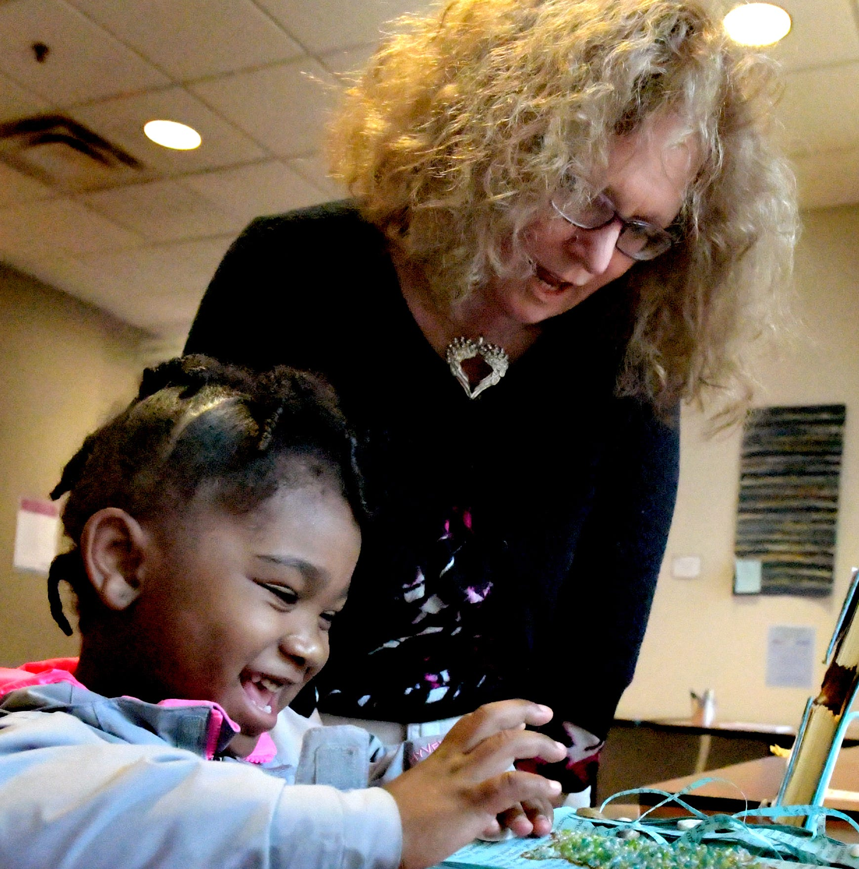 "Noriah Turpin, 4, of York City, looks at a book with Deb Sullivan, Community Relations Director for York County Libraries, at Martin Library in York City Thursday, October 18, 2018. Norah and her mother participate in the ""1,000 Books before Kindergarten"" program recently launched by the county library system. The library was named ""Library of the Year"" at the Pennsylvania Library Association Annual Conference. Statewide nominations were considered with Martin chosen as the first library in Pennsylvania to earn the award. Bill Kalina photo"