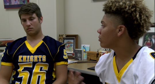 Eastern York High School senior football players Drake Brown, left, and Demonte Martin reflect on a fatal bus crash nearly a year after the tragedy.