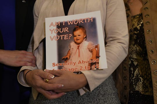 Carolyn Fortney, a survivor of sexual abuse at the hands of her family's Roman Catholic parish priest as a child, awaits legislation in the Pennsylvania Capitol to respond to a landmark state grand jury report on child sexual abuse in the Catholic Church, Wednesday, Oct. 17, 2018 in Harrisburg, Pa. (AP Photo/Marc Levy)