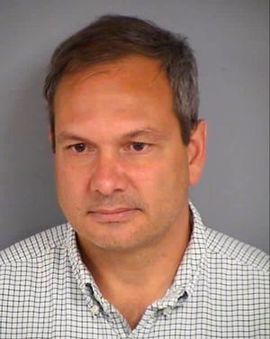 This undated photo provided by the Las Vegas Department of Public Safety shows Wilfred Michael Stark, 50, of Falls Church, Va. Authorities say Stark was arrested Tuesday, Oct. 16, 2018, on a misdemeanor battery charge after he was accused of pushing into a Republican party event and grabbing the manager of Nevada state Attorney General Adam Laxalt's gubernatorial campaign.