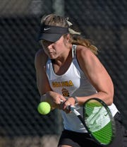 Galena's Ally Cohen hits a backhand to Summer Stadtlander of Faith Lutheran in the state team simifinals at Bishop Manogue High School on Oct 17, 2018.
