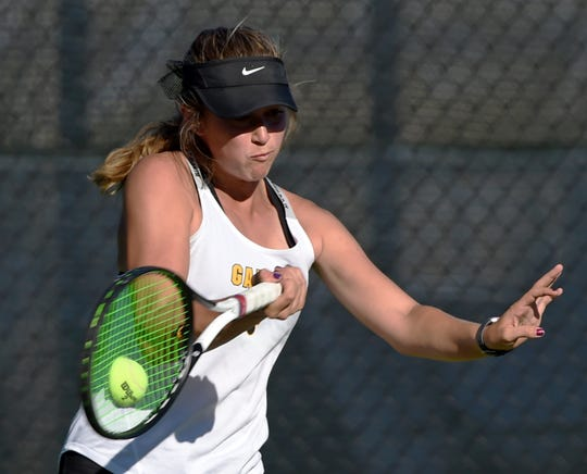 Galena's Ally Cohen hits a forehand to Summer Stadtlander of Faith Lutheran in the State Team Simifinals at Bishop Manogue High School on Oct 17, 2018.