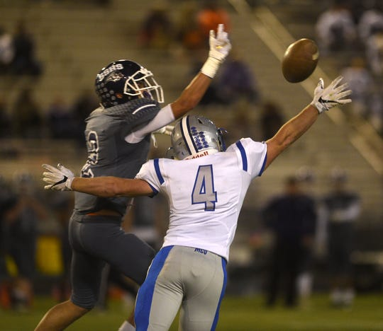 McQueen's Nick Ryan (4) breaks up a pass intended for Spanish Springs' Colby Melton during their football game in Reno on Oct. 5.