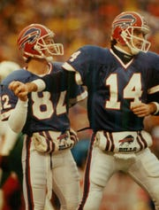 Don Beebe and Frank Reich celebrating during the Bills' comeback victory over Houston.