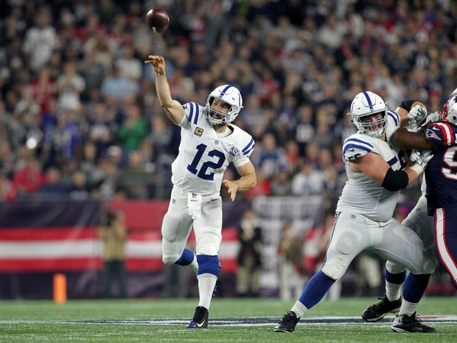 Indianapolis Colts quarterback Andrew Luck (12) throws a pass against the New England Patriots during the fourth quarter at Gillette Stadium. His next test is Buffalo Bills No. 3 defense, which has collected 19 sacks. Luck has been sacked just 10 times.