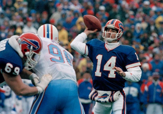 """Quarterback Frank Reich of the Buffalo Bills passes during the game against the Houston Oilers that has come to be known as """"The Comeback,"""" at Rich Stadium in Orchard Park, N.Y., Jan. 3, 1993. The Bills, 32 points behind, came back to win in overtime, 41-38. The game holds the record for the largest comeback in the history of the NFL. Reich is now coach of the Indianapolis Colts."""