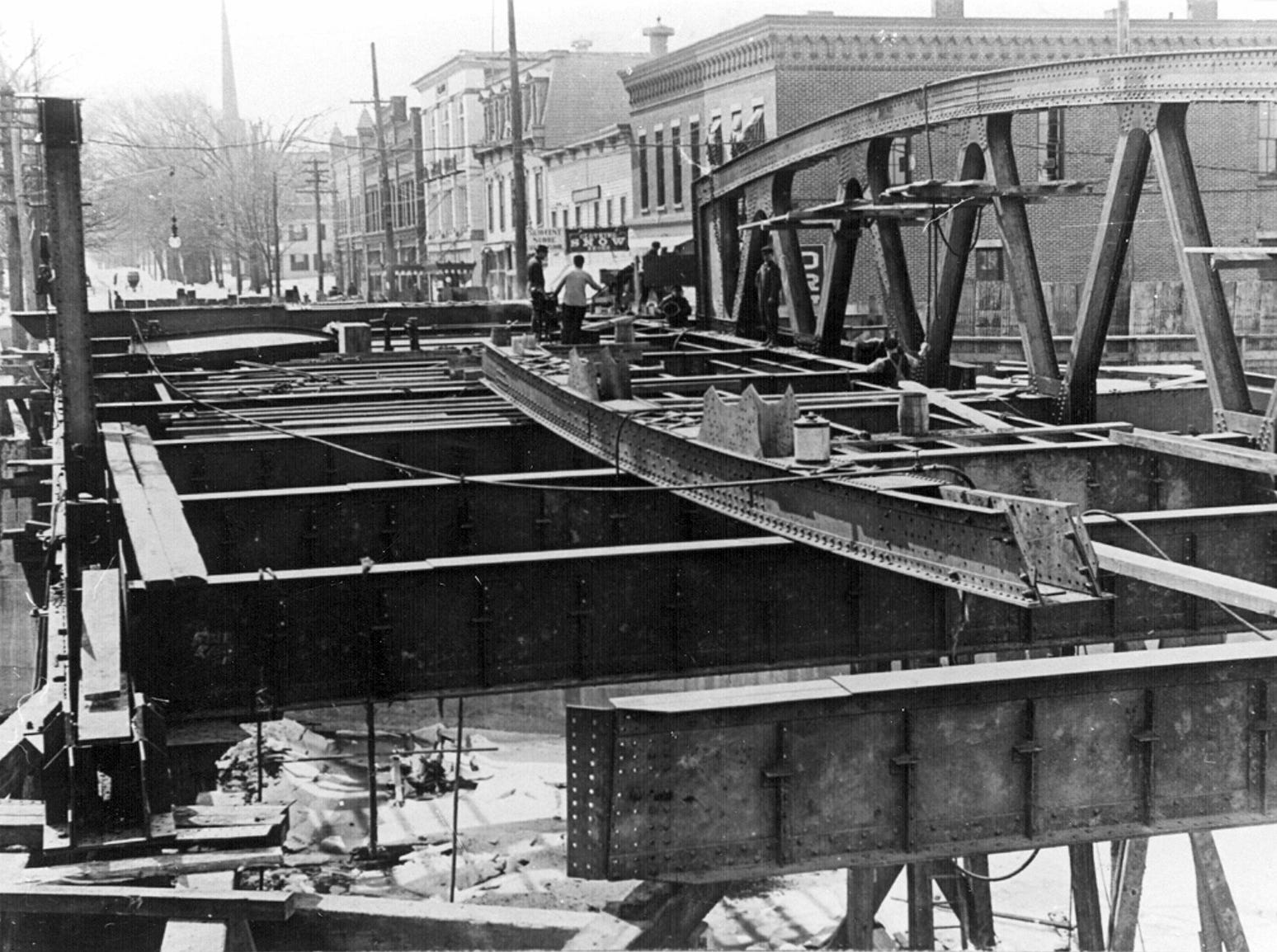 Construction work continues on the Fairport lift bridge over the Erie Canal in this 1914 photo.
